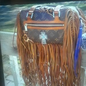 Louis bag refurbished by the best artist